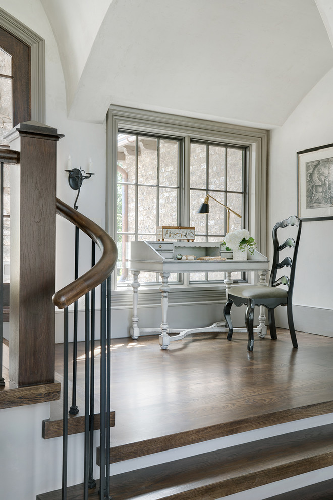 Inspiration for a timeless freestanding desk medium tone wood floor and brown floor home office remodel in Other with white walls