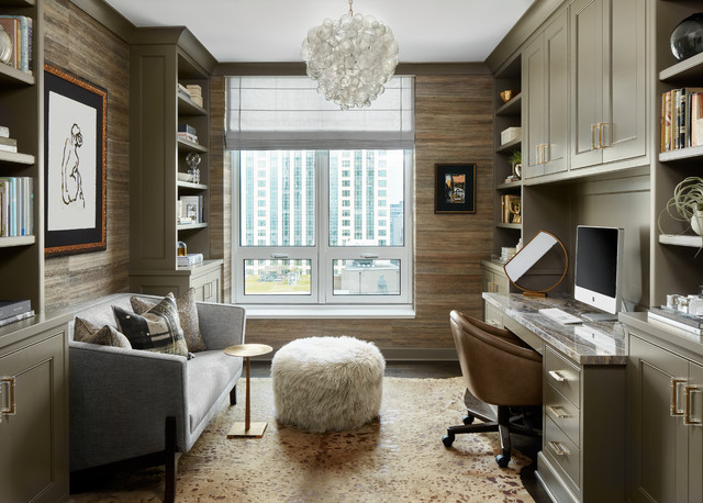 Example of a small transitional built-in desk dark wood floor and brown floor home office library design in Chicago with no fireplace and brown walls