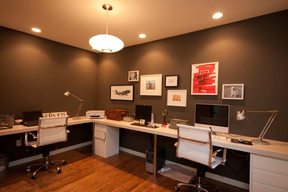 Home office - modern home office idea in Seattle with brown walls