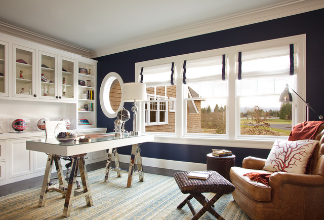 Home office - large beach style freestanding desk dark wood floor home office idea in Portland with blue walls, a two-sided fireplace and a wood fireplace surround