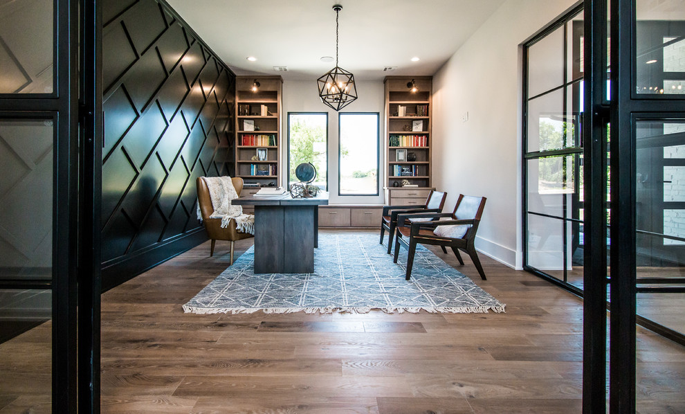 Example of a large trendy freestanding desk medium tone wood floor and brown floor home office design in Other with white walls and no fireplace