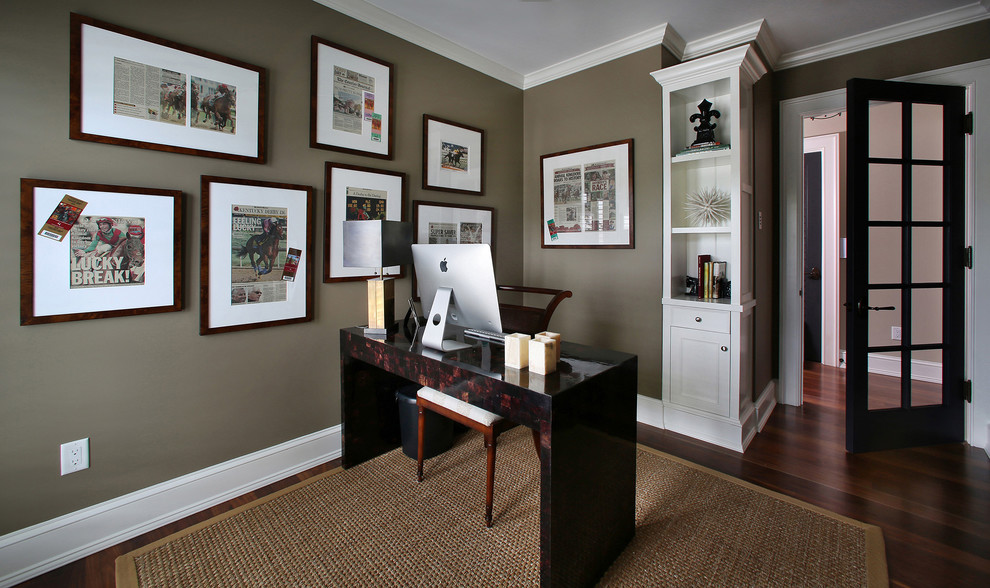Home office - tropical home office idea in Tampa with brown walls