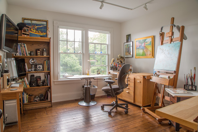 Home studio - mid-sized traditional freestanding desk medium tone wood floor and brown floor home studio idea in Providence with white walls