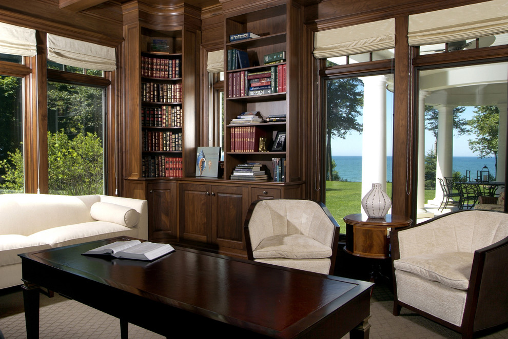 Inspiration for a large transitional freestanding desk carpeted home office remodel in Grand Rapids