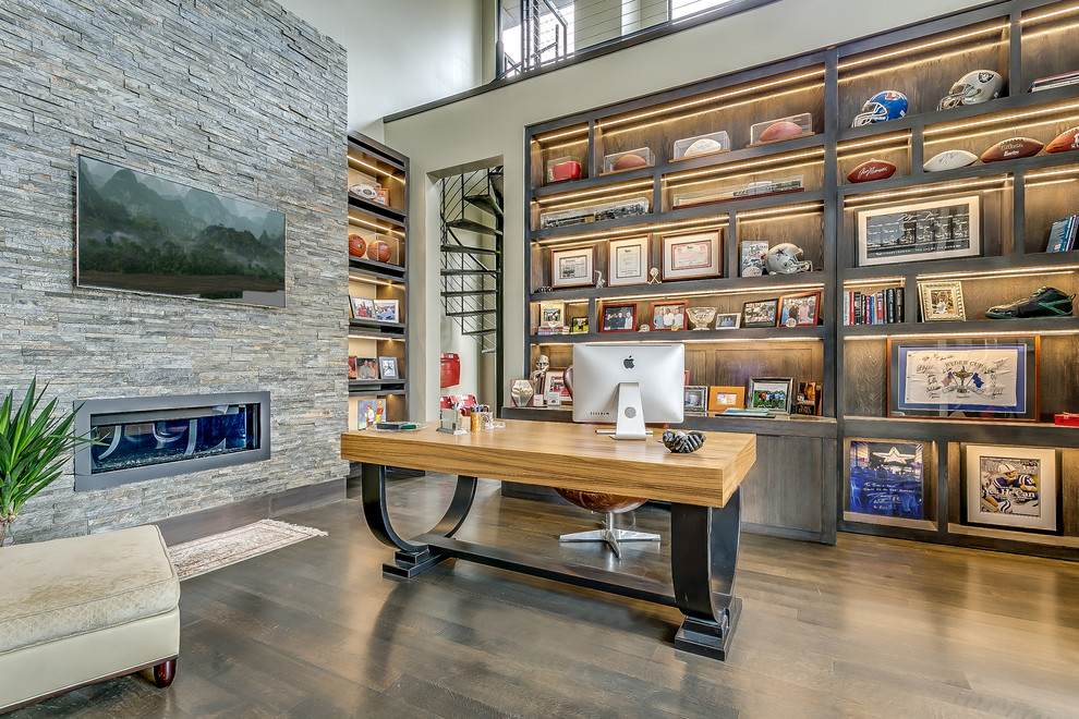 Transitional freestanding desk dark wood floor study room photo in Dallas with beige walls and a ribbon fireplace