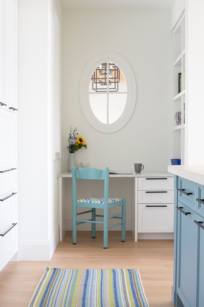 Study room - small coastal built-in desk light wood floor study room idea in Minneapolis with white walls