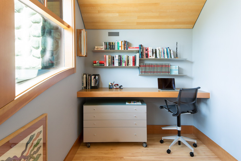Example of a small minimalist built-in desk light wood floor and brown floor study room design in Vancouver with gray walls and no fireplace