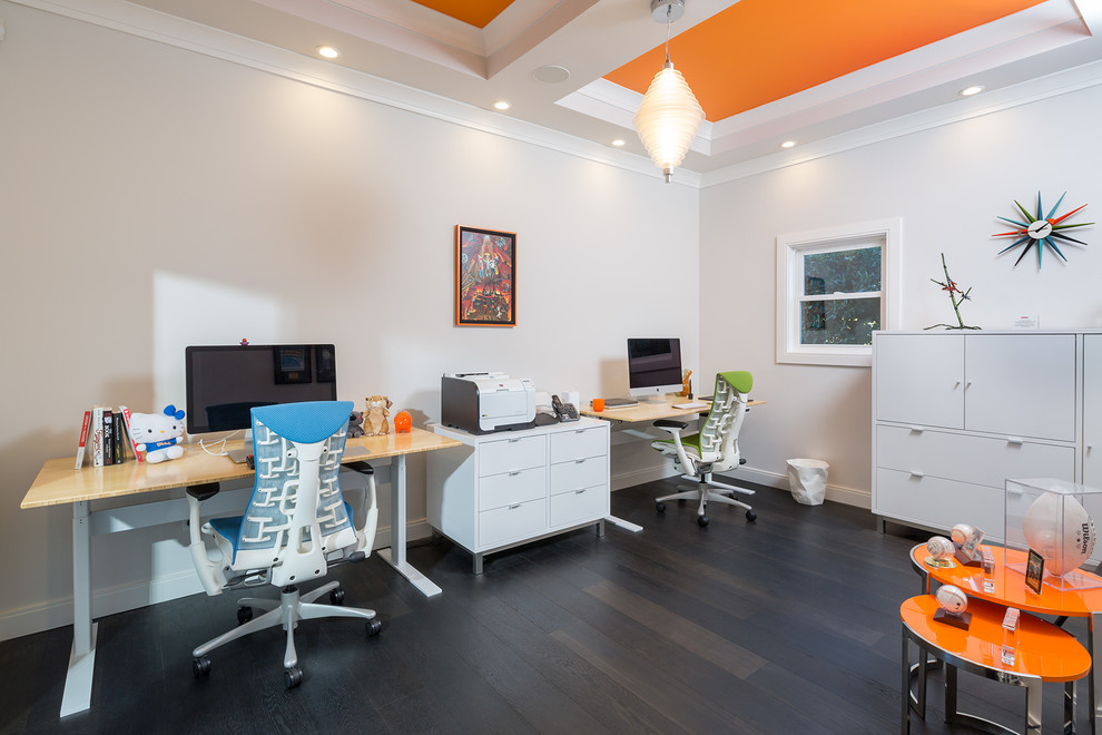 Home office - mid-sized contemporary freestanding desk dark wood floor and brown floor home office idea in Los Angeles with beige walls and no fireplace