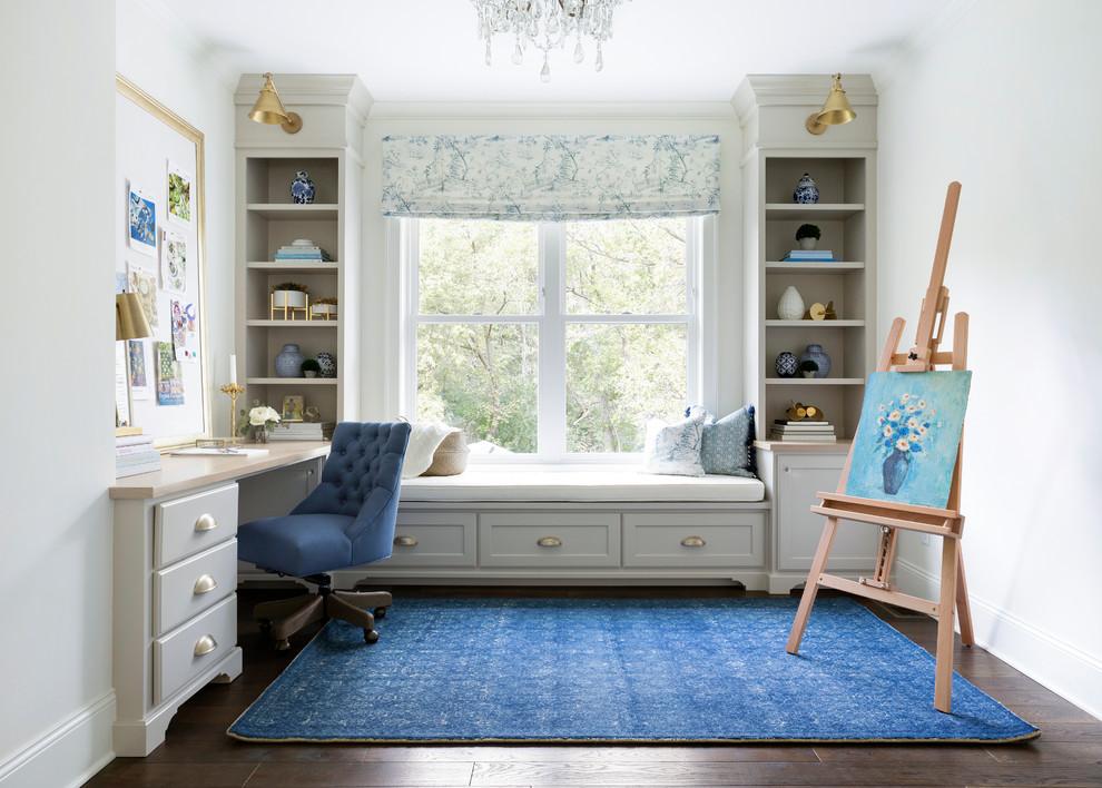 Home studio - traditional built-in desk dark wood floor home studio idea in Minneapolis with white walls