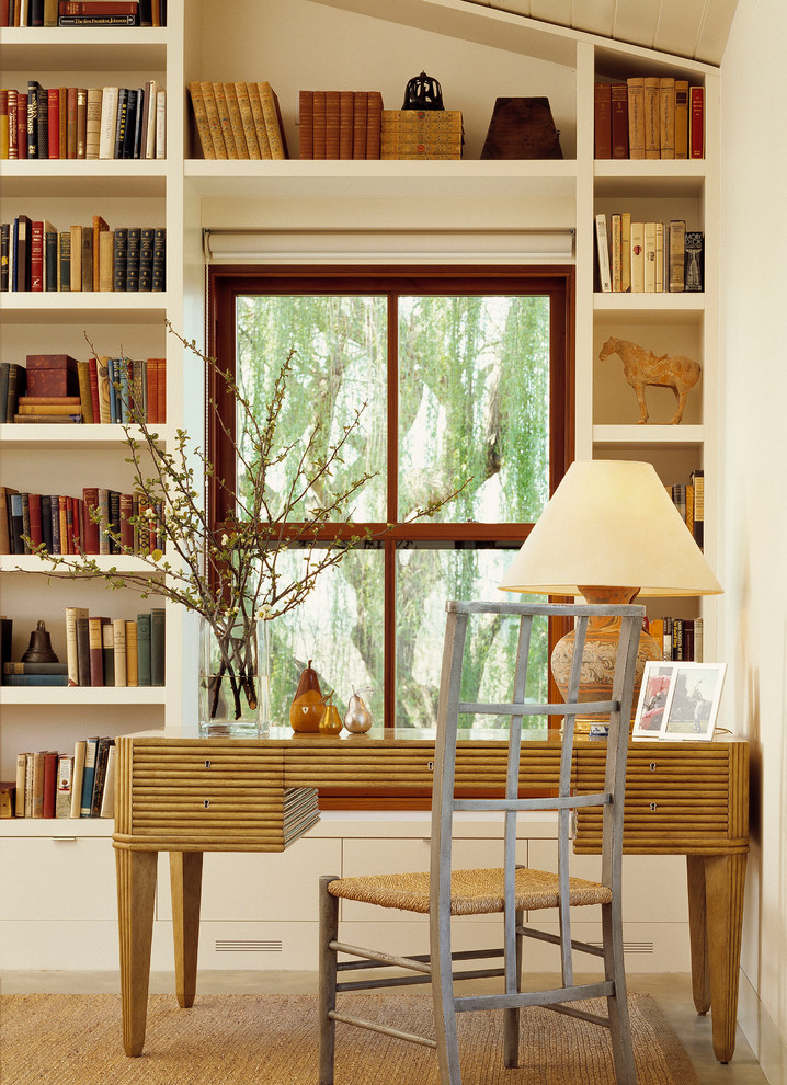 Inspiration for a transitional freestanding desk home office remodel in Sacramento with white walls