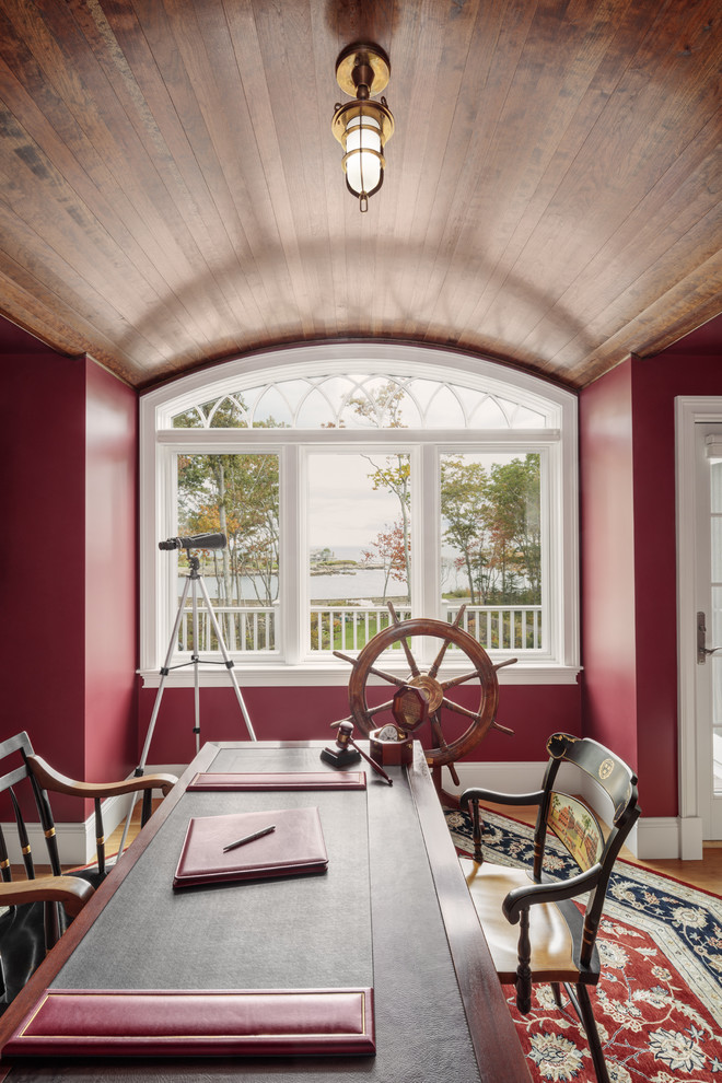 Example of a mountain style freestanding desk light wood floor study room design in Portland Maine with red walls and no fireplace