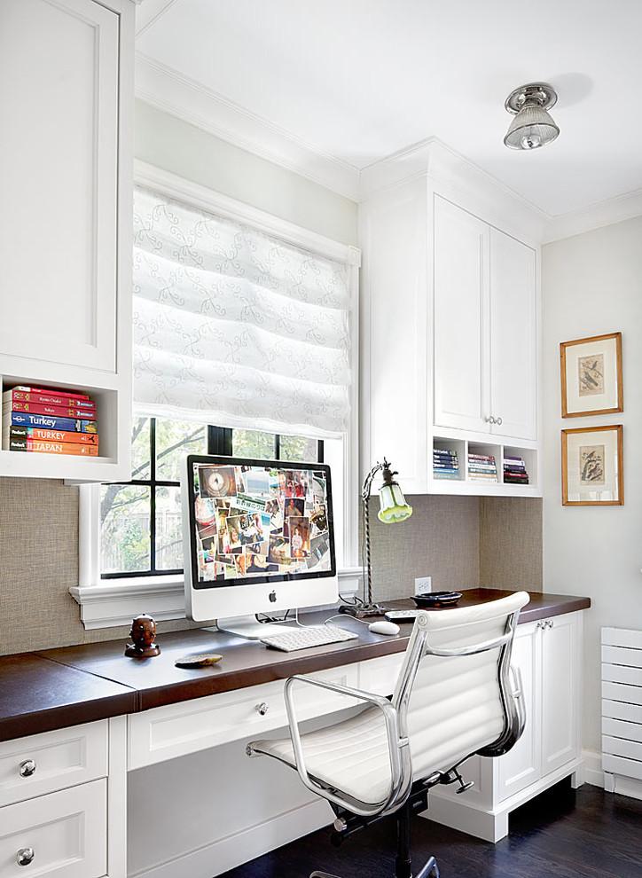 Elegant built-in desk home office photo in Chicago