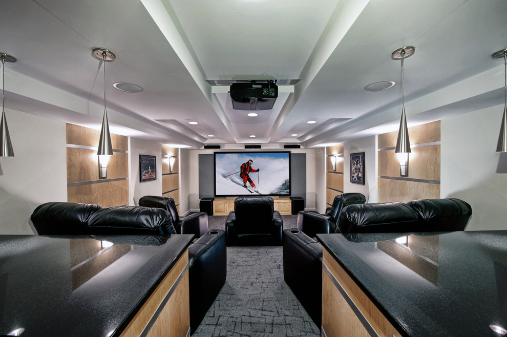 Example of a mid-sized trendy open concept carpeted and gray floor home theater design in DC Metro with multicolored walls and a projector screen