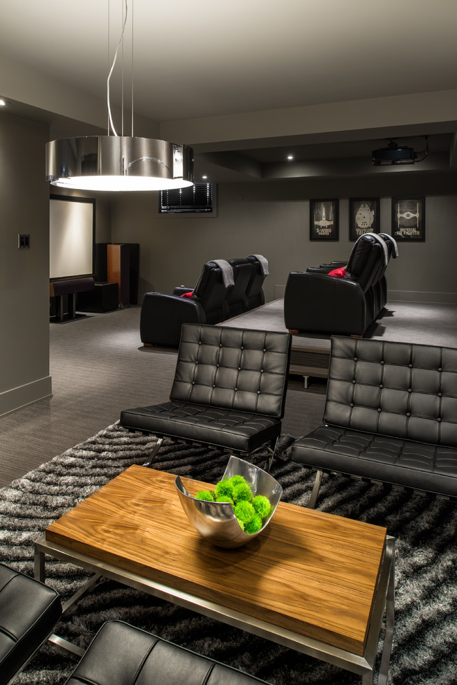 Inspiration for a contemporary gray floor home theater remodel in Ottawa with gray walls