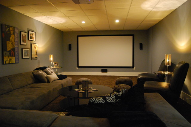 basement media room with sectional sofa and giraffe texture