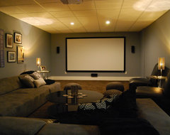 Basement media room with sectional sofa and giraffe texture carpeting modern media room