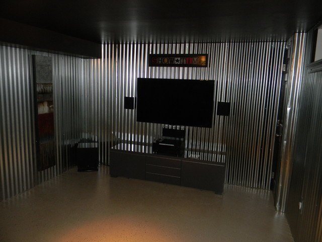 Aluminum walls, painted ceiling, floor and installed tv and surround ...