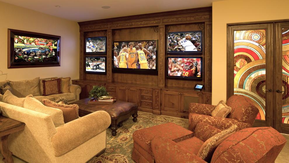 Home theater - mediterranean carpeted home theater idea in Los Angeles with a wall-mounted tv