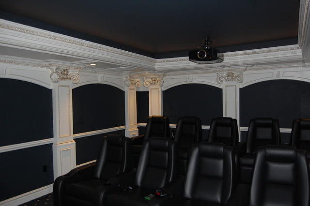Large elegant enclosed carpeted and blue floor home theater photo in New York with blue walls and a projector screen