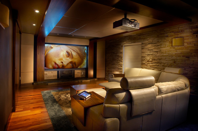 Comfy home theatre and family room modern home theater montreal by maria deschamps design Modern home theater design ideas
