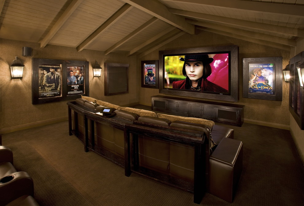 Inspiration for a rustic enclosed home theater remodel in Los Angeles with a media wall
