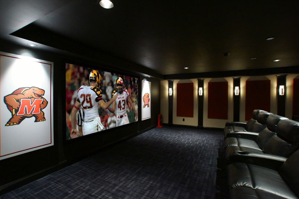 Large elegant open concept carpeted home theater photo in Baltimore with black walls and a projector screen
