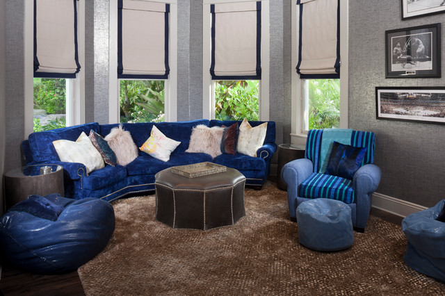 Inspiration for a timeless enclosed dark wood floor home theater remodel in Tampa with gray walls and a wall-mounted tv
