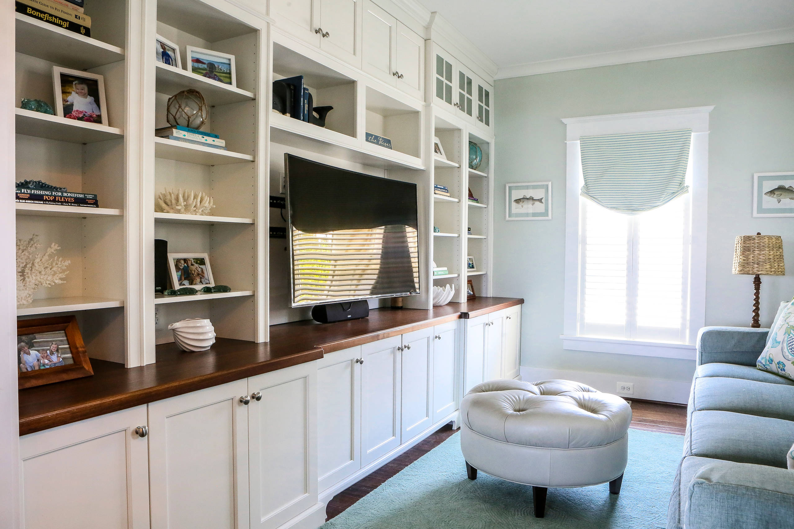 Entertainment Room With Custom Built-in Shelving and Cabinetry