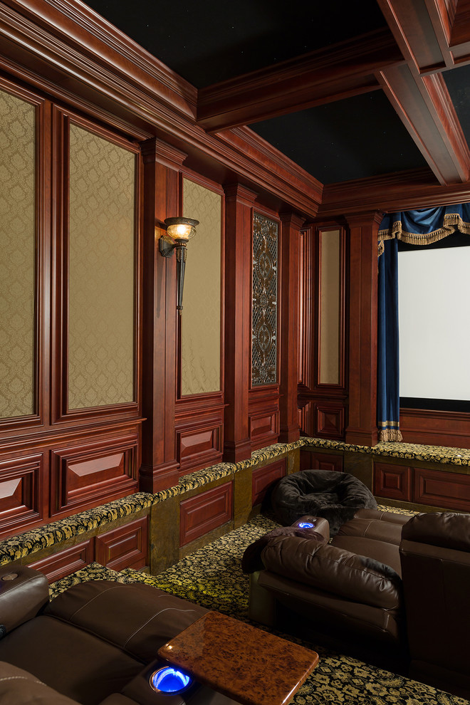 Huge elegant enclosed carpeted and black floor home theater photo in Raleigh with brown walls and a projector screen