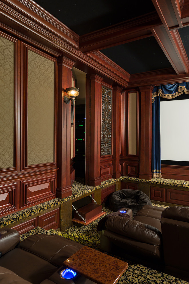 Inspiration for a large timeless enclosed carpeted and yellow floor home theater remodel in Raleigh with brown walls and a projector screen