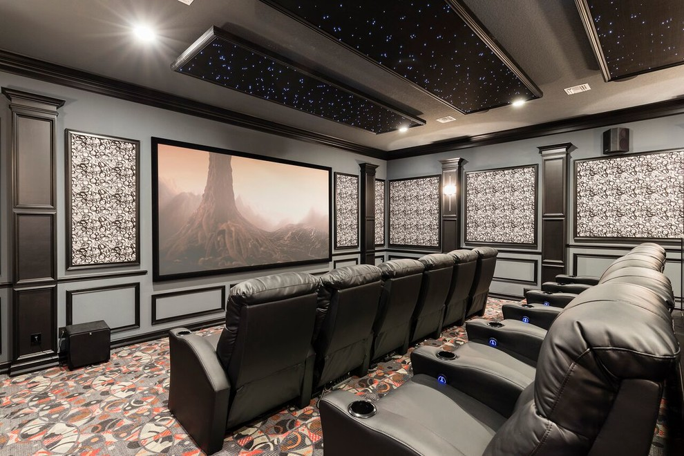 Example of a tuscan enclosed carpeted and multicolored floor home theater design in Orlando with multicolored walls and a projector screen