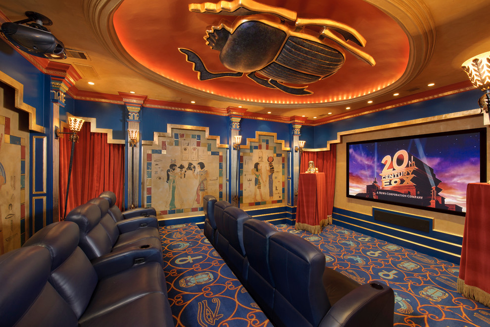 Inspiration for a mediterranean home theater remodel in Houston with a projector screen