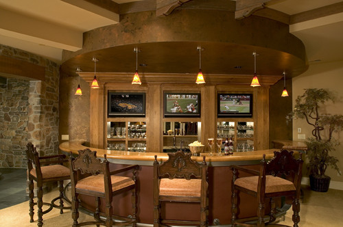 A home bar offers extra entertainment space.