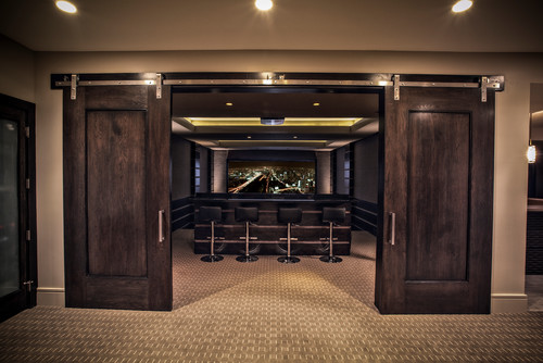 opening these fancy barn doors reveals an impressive home theater system its time to watch a movie - Home Theater Stage Design