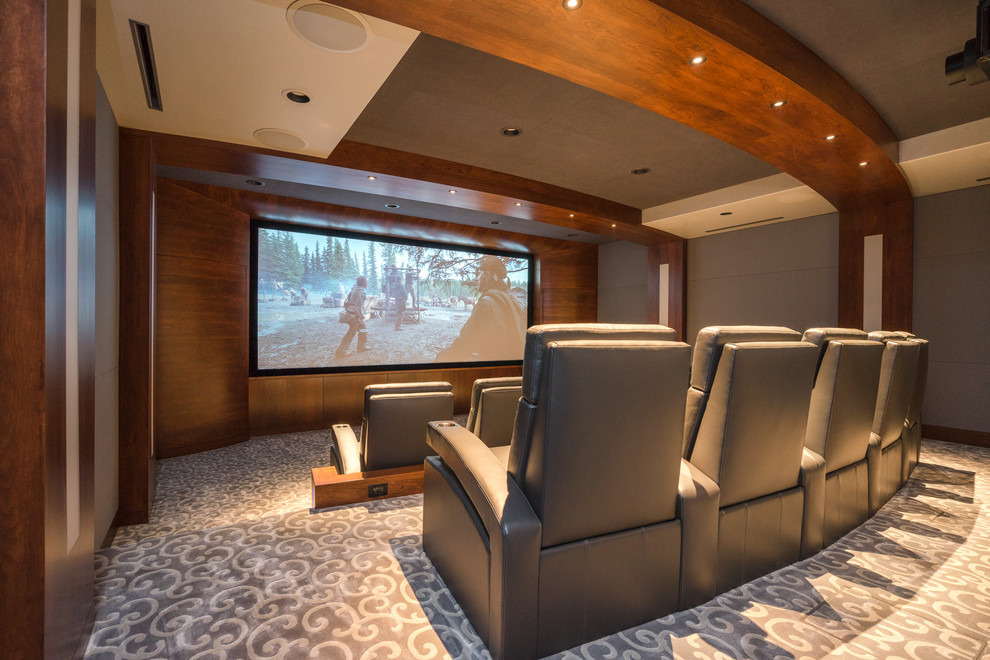 Inspiration for a large contemporary enclosed carpeted and gray floor home theater remodel in Other with gray walls and a projector screen