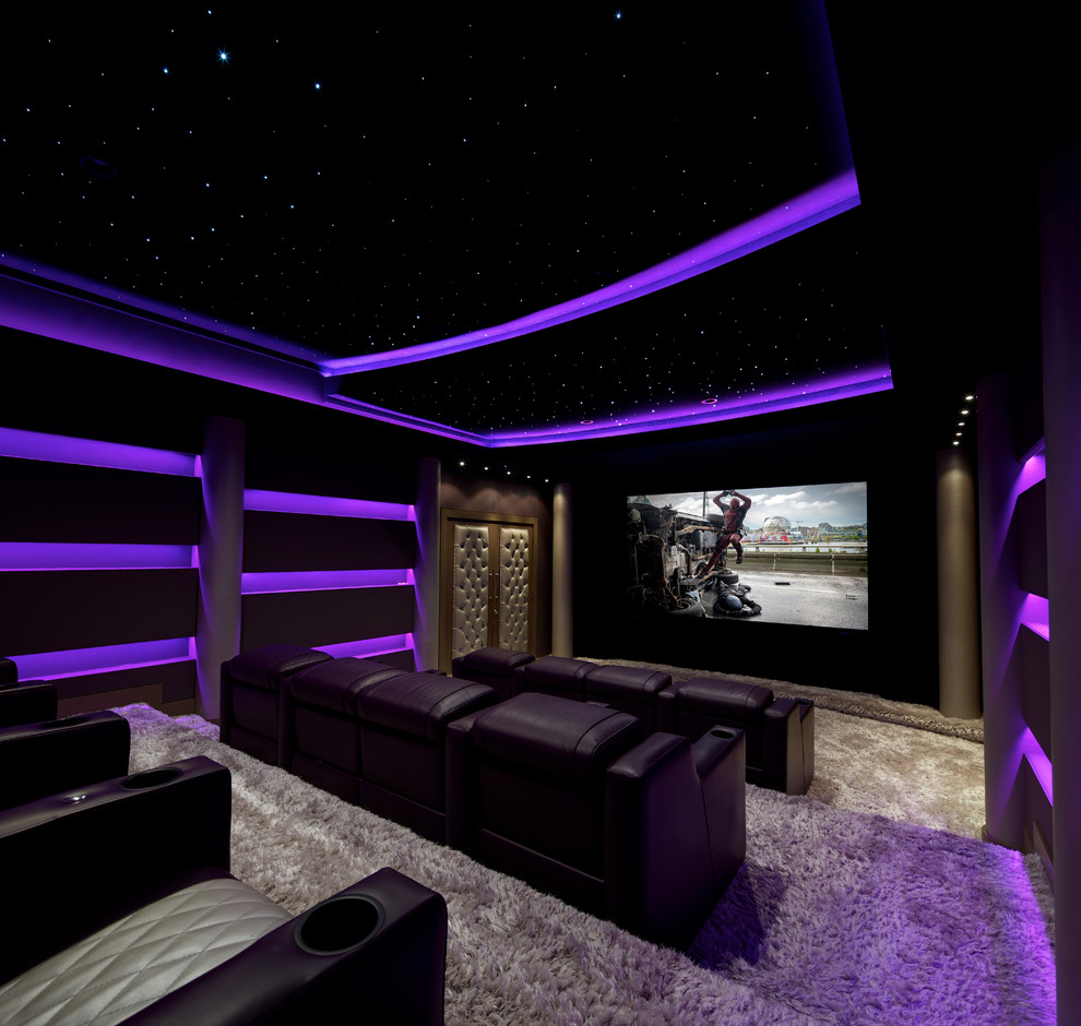 Inspiration for a large contemporary enclosed carpeted and beige floor home theater remodel in New York with black walls and a media wall