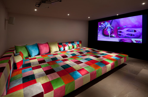 Watch TV and games in grandeur on this extreme sofa. Love the patchwork textiles