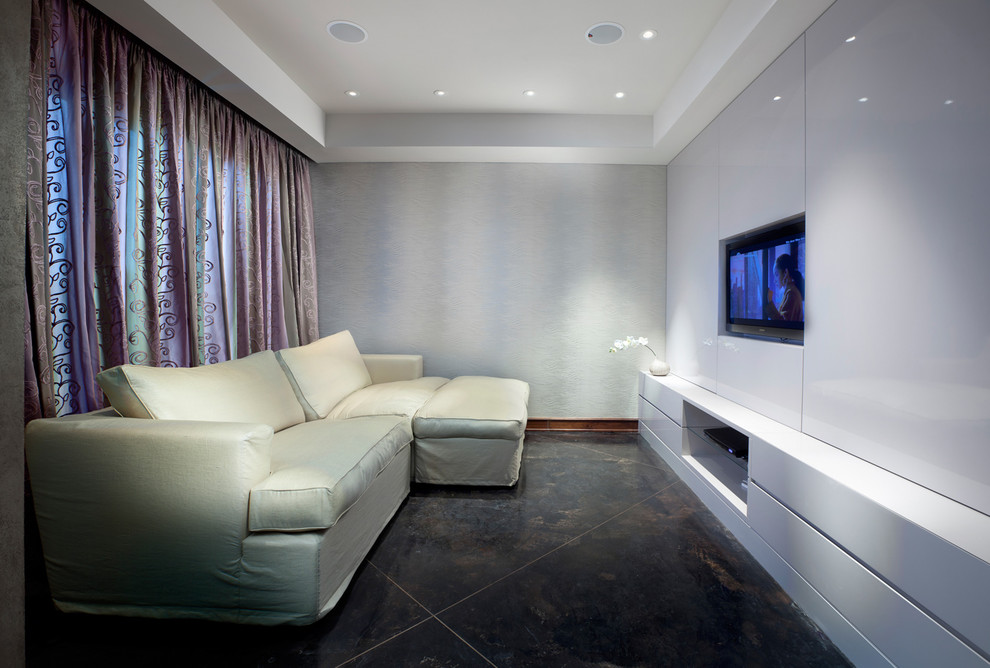 Inspiration for a contemporary enclosed home theater remodel in Other with white walls and a wall-mounted tv