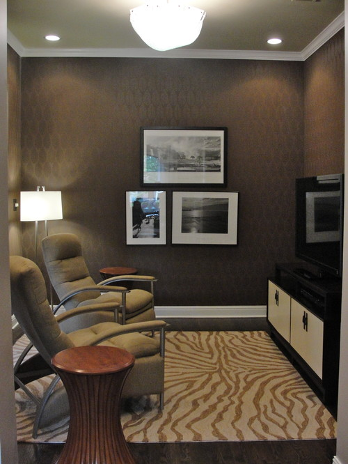 Not all media rooms are big! But they can all be lit well with smart elements like a ceiling-mount light. Photo credit: Contemporary Home Theater by Chicago Interior Designers & Decorators Rebekkah Davies Interiors + Design