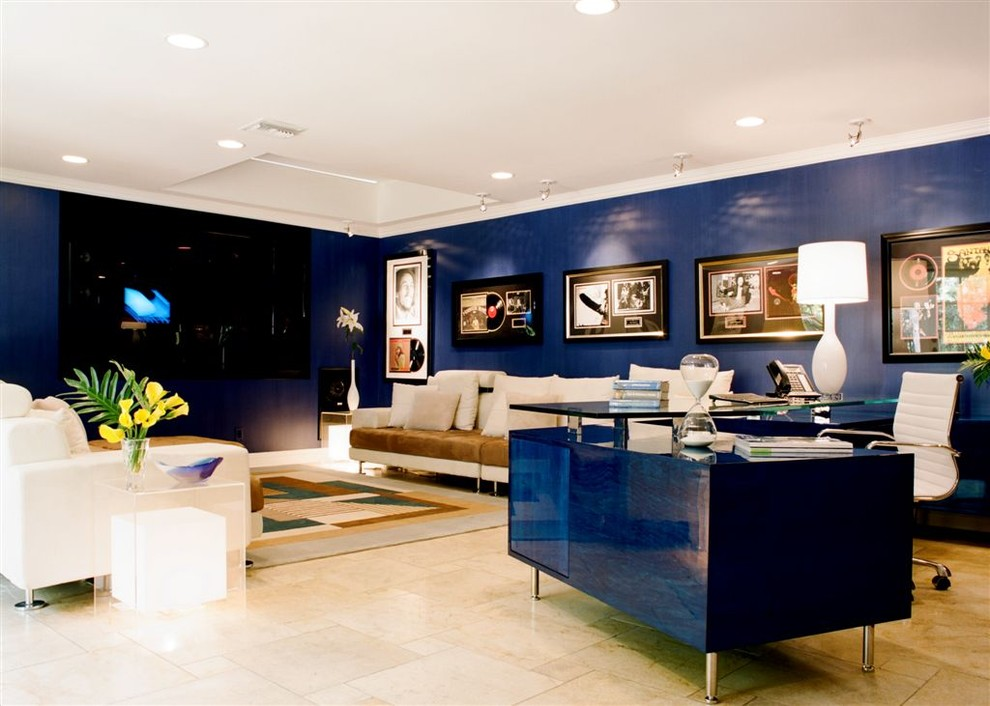 Inspiration for a contemporary home theater remodel in Los Angeles with blue walls
