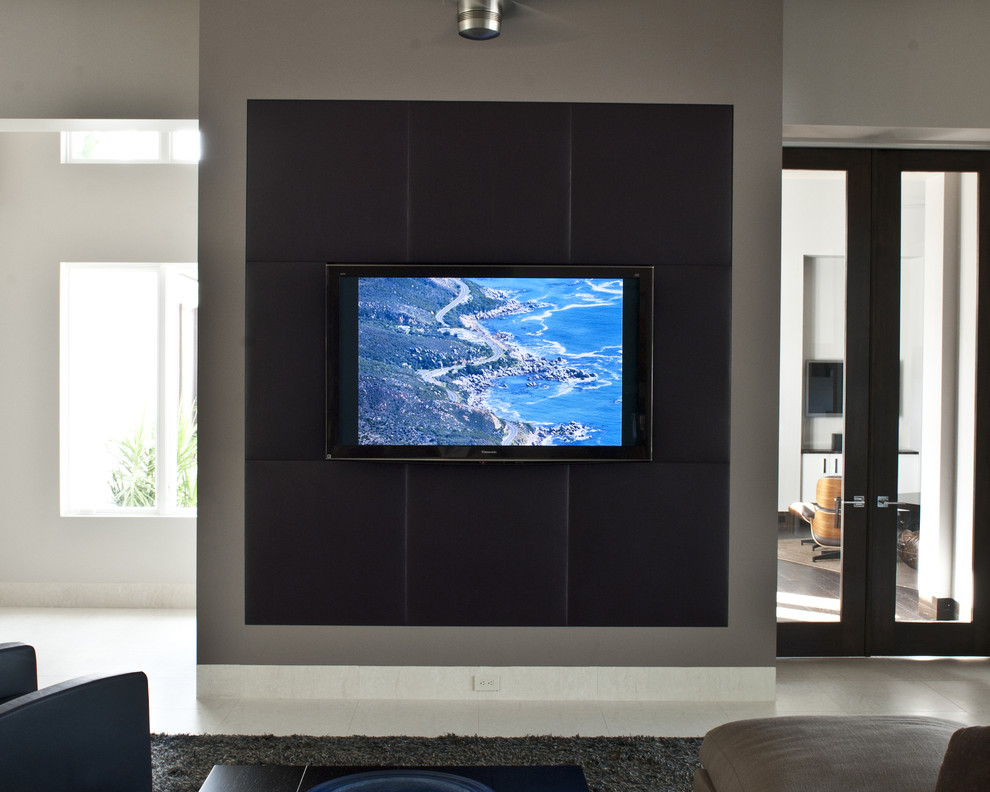 Inspiration for a contemporary home theater remodel in Tampa with a wall-mounted tv