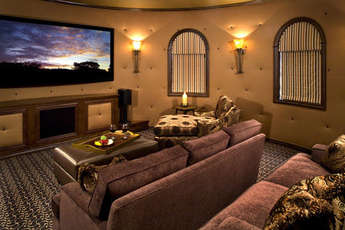 Use torchiere-style wall sconces like Kalco Santa Barbara to get this media room look. Photo credit: Mediterranean Home Theater by Scottsdale Interior Designers & Decorators VM Concept Interior Design Studio