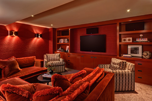 Get cozy comfortable on a red sofas and red media room. This would be a great place to watch TV and movies