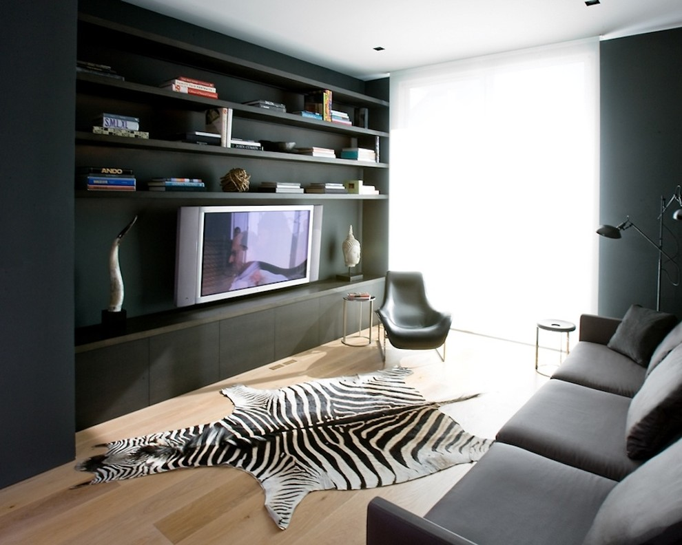 Trendy enclosed home theater photo with a media wall
