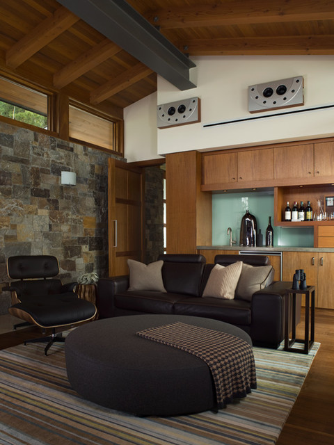 Modern Media Space with Stone facade - Hillside Residence rustic-home-theater