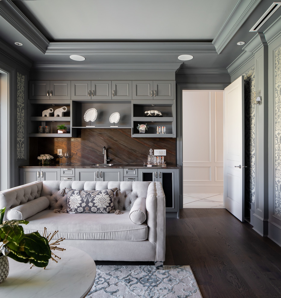 Design ideas for a large modern enclosed home cinema in Vancouver with grey walls, dark hardwood flooring, a projector screen and brown floors.