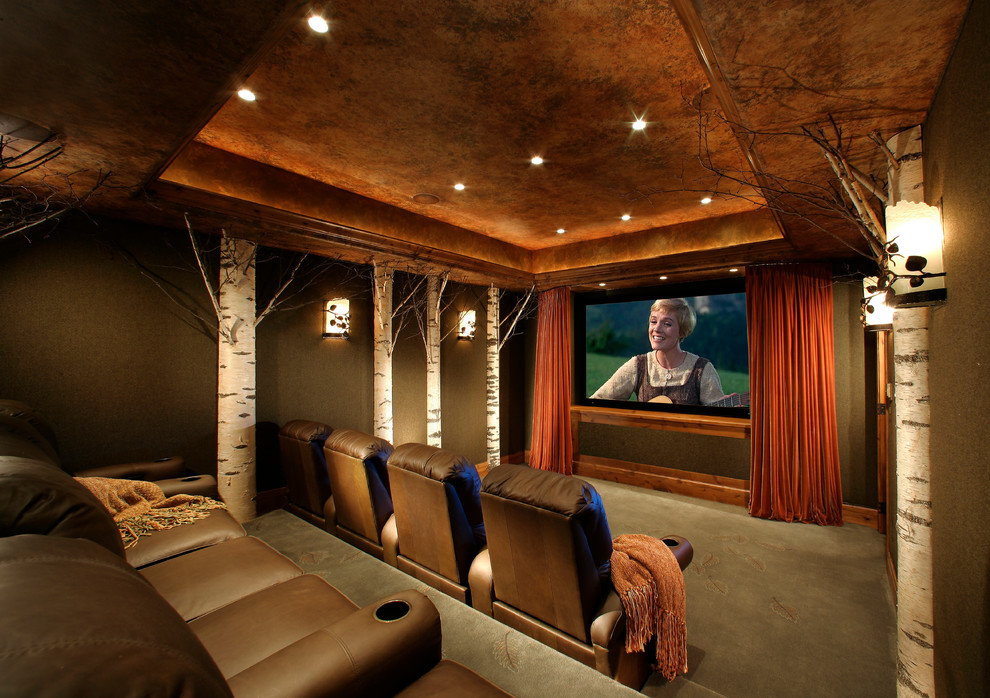 Inspiration for a large timeless enclosed carpeted and green floor home theater remodel in Phoenix with a projector screen and green walls
