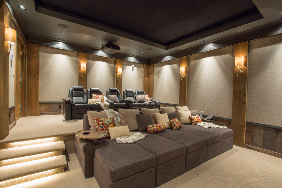 Home theater - large contemporary enclosed carpeted home theater idea in Denver with beige walls and a projector screen