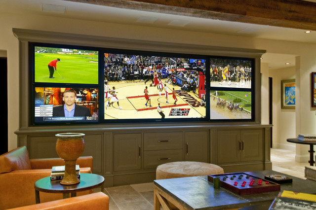 Home Theater Rustic Idea In Los Angeles With A Media Wall