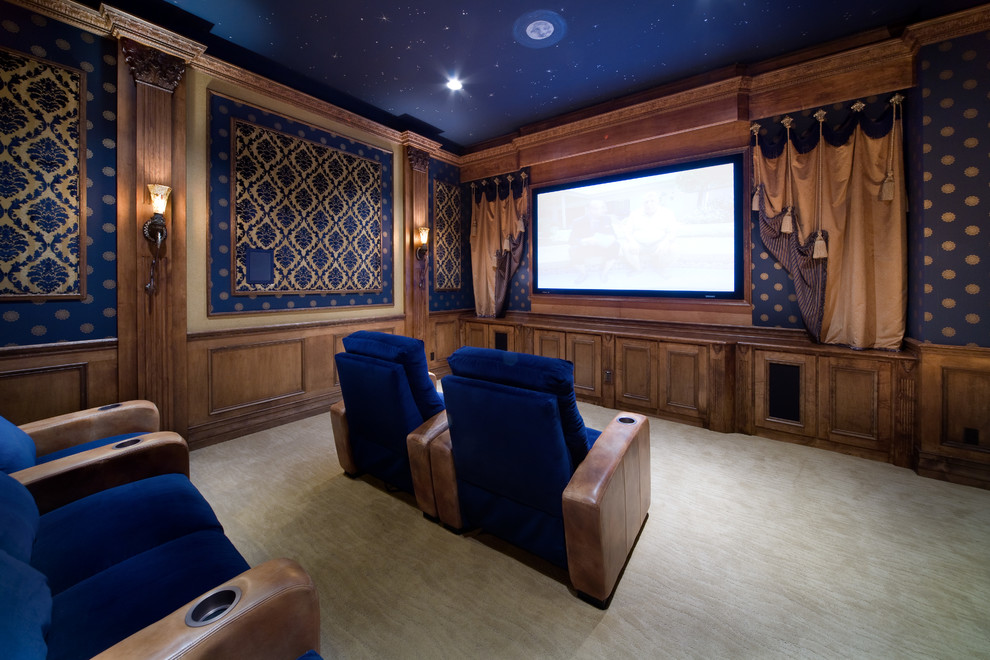 Inspiration for a timeless enclosed carpeted and beige floor home theater remodel in Orlando with blue walls